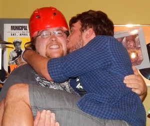 Looks like Anthony's helmet didn't do a very good job of staving off Jon's public display of affection for his bandmate!