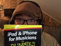 Ryan holding the newest book - iPad and iPhone For Musicians For Dummies!