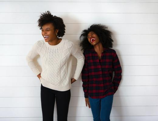 Two black female friends laughing on the BDC Collective by BDC Digital Media both by Brenda Della Casa