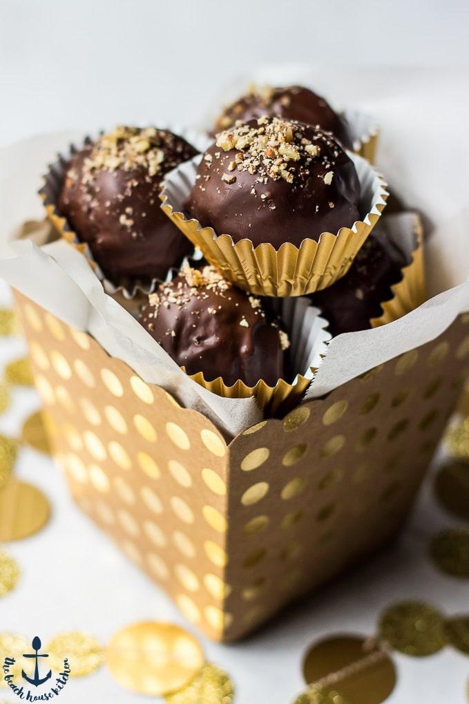 Up close photos of Pecan Pie Truffles in gold polka dot cardboard box.