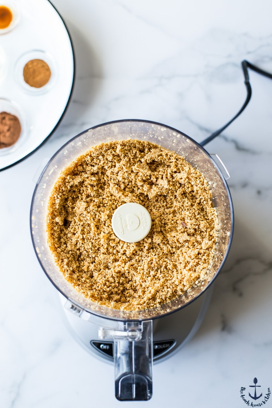 Overhead photo of crushed peanuts in food processor