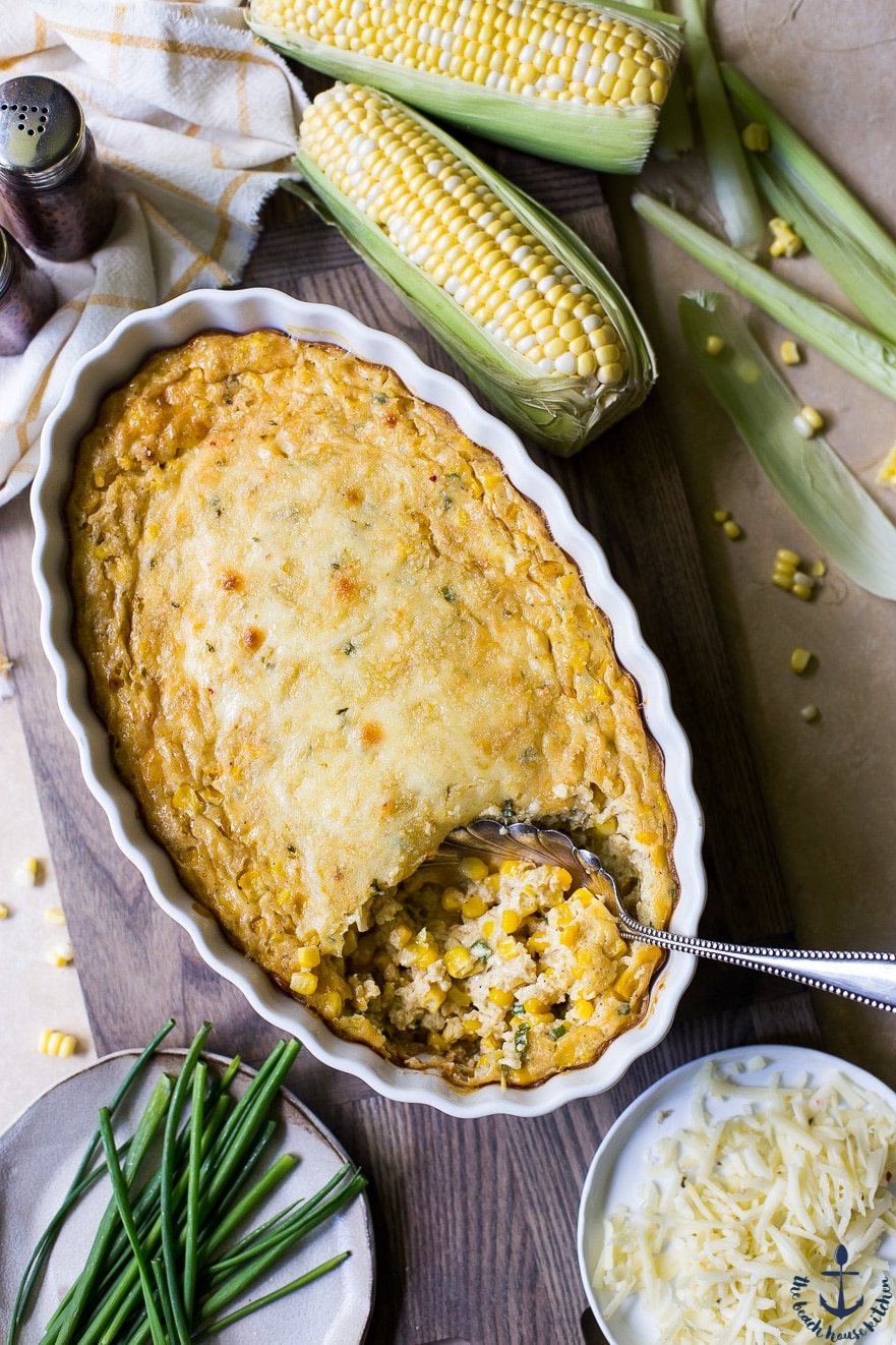 Overhead photo of Cheesy Corn Casserole with a few ears of corn