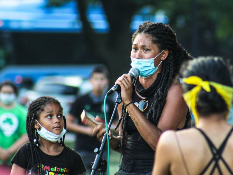 Jenay Manley addresses a group of protesters on July 4 at Mill Creek Park during the Freedom Rally. Zachary Linhares/The Beacon