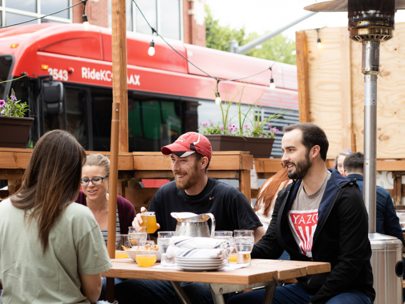 People hanging out on the street patio on a Friday afternoon at City Barrel Brewery +Kitchen along Holmes Street in downtown Kansas City.