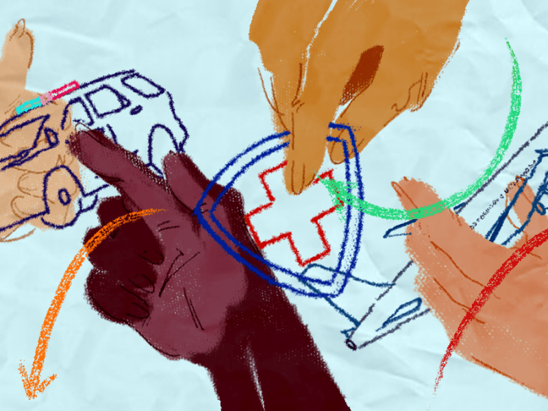 Several hands move a police car, a health logo, and an airplane around a sheet of paper.