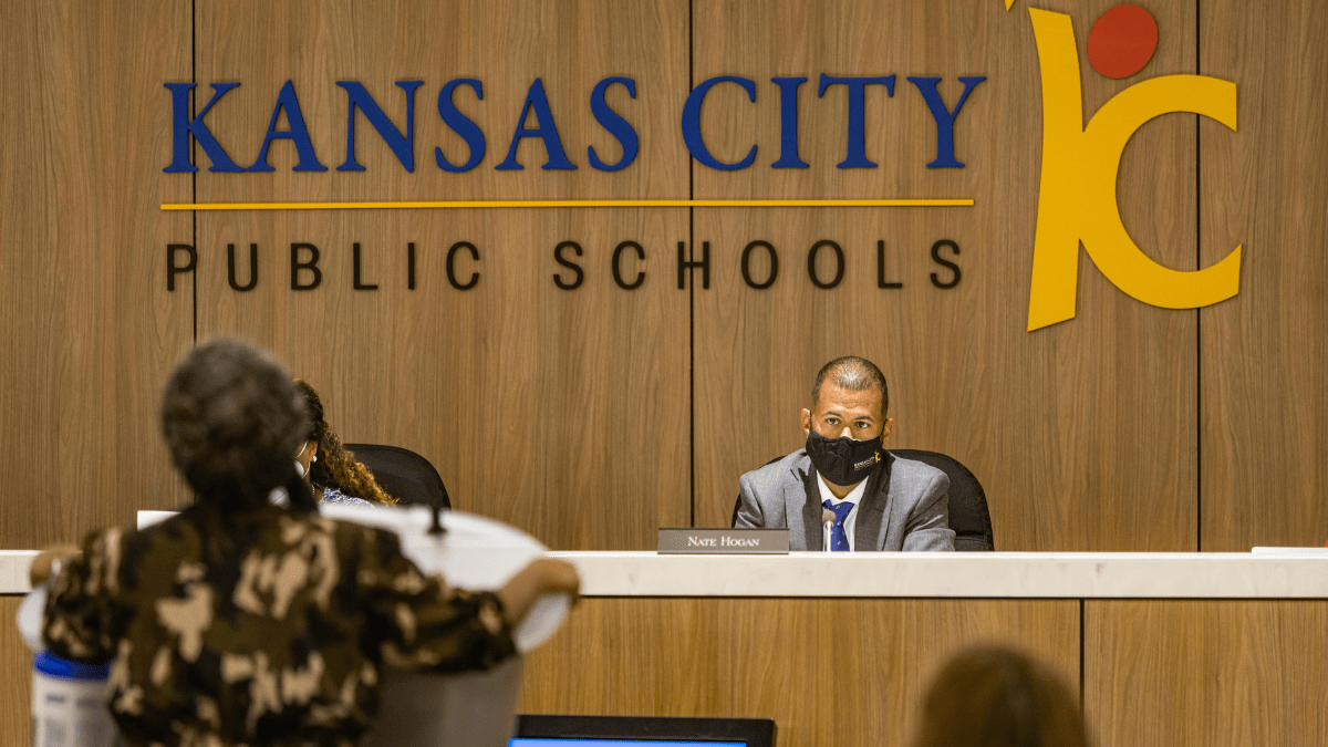 Kansas City Public Schools Board Chair Nate Hogan listens to Alicia Black-Mackey speak about her concerns with changes at Paseo Academy during the public comment period of a school board meeting July 21, 2021 in Kansas City, Missouri.