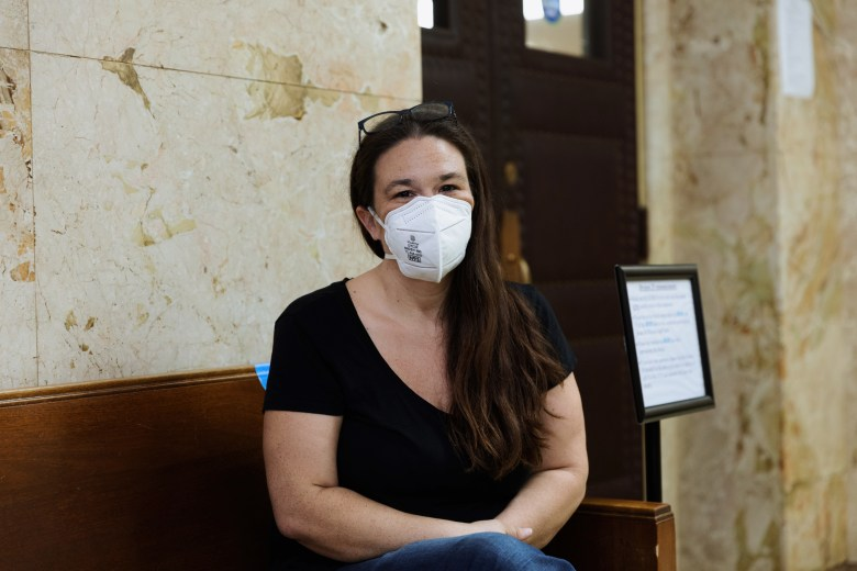 Jennifer Bosley awaits her eviction hearing at the Jackson County Courthouse on Sept. 2.