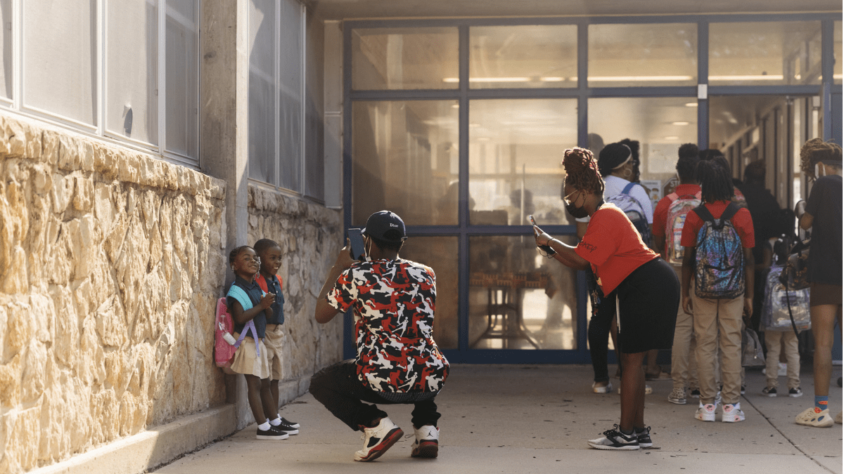 From left to right, Melanie Blount, Terrance Blount Jr., Terrance Blount Sr. and Tania Bolton, commemorated the first day of school in front of African-Centered College Preparatory Academy on Aug. 23 in Kansas City.