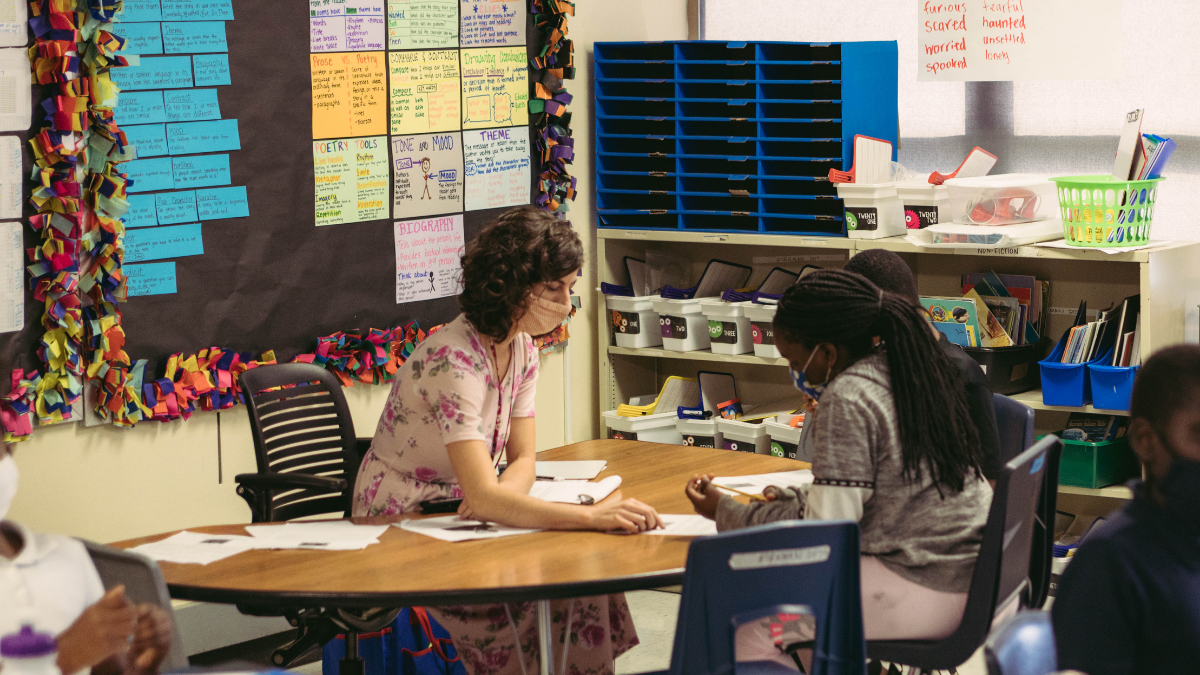 A teacher works with a small group of students in a fourth grade classroom at Garfield Elementary School in Kansas City.