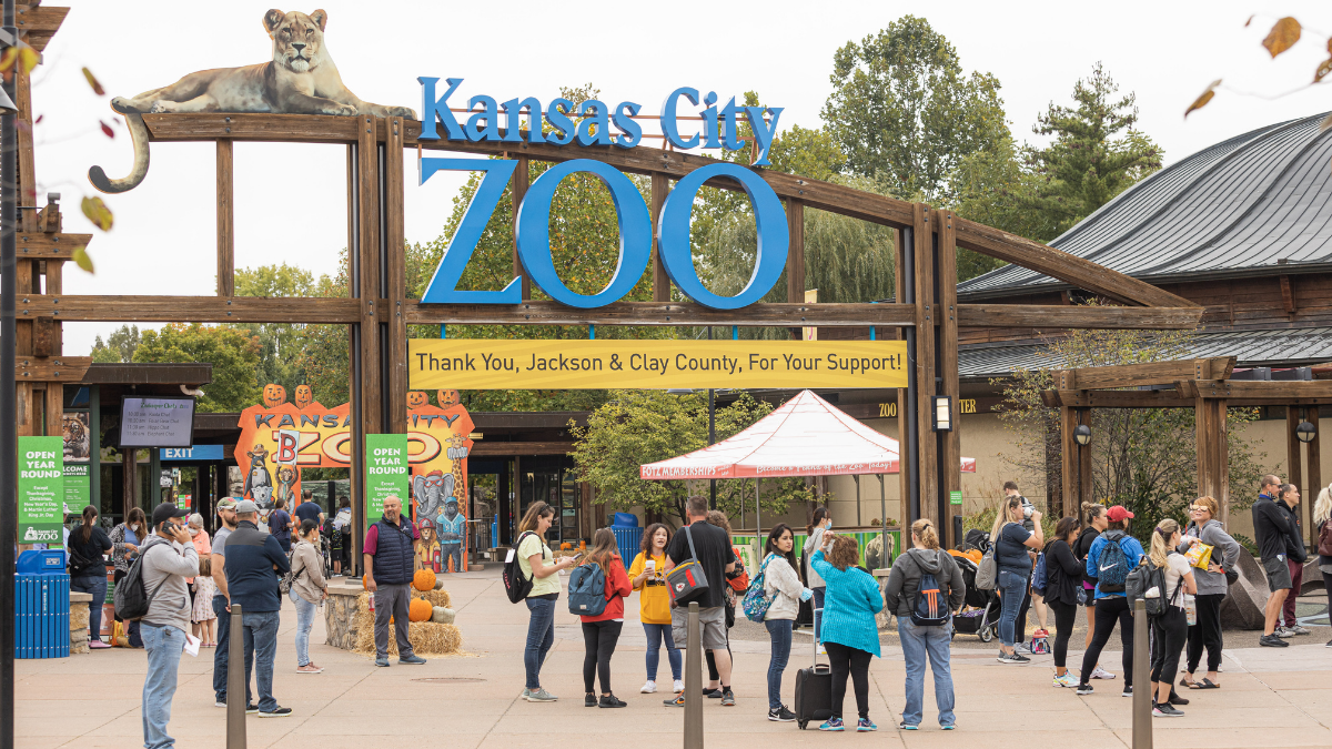 Visitors line up at the entrance of the Kansas City Zoo.