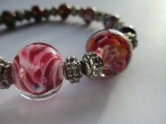 with glass lampwotk beads and silver tone spacers.
