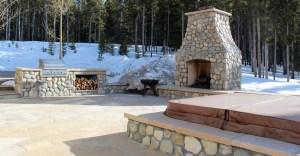 outdoor fireplace and hot tub