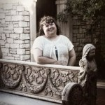Tammy Jo Burns sepia photo near an ornate stone bench