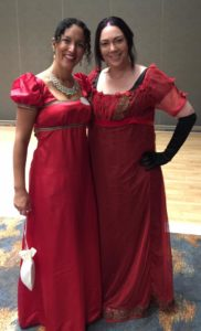 Photo of Erica Ridley (left) an Emma Locke (Right) in their Regency finery.