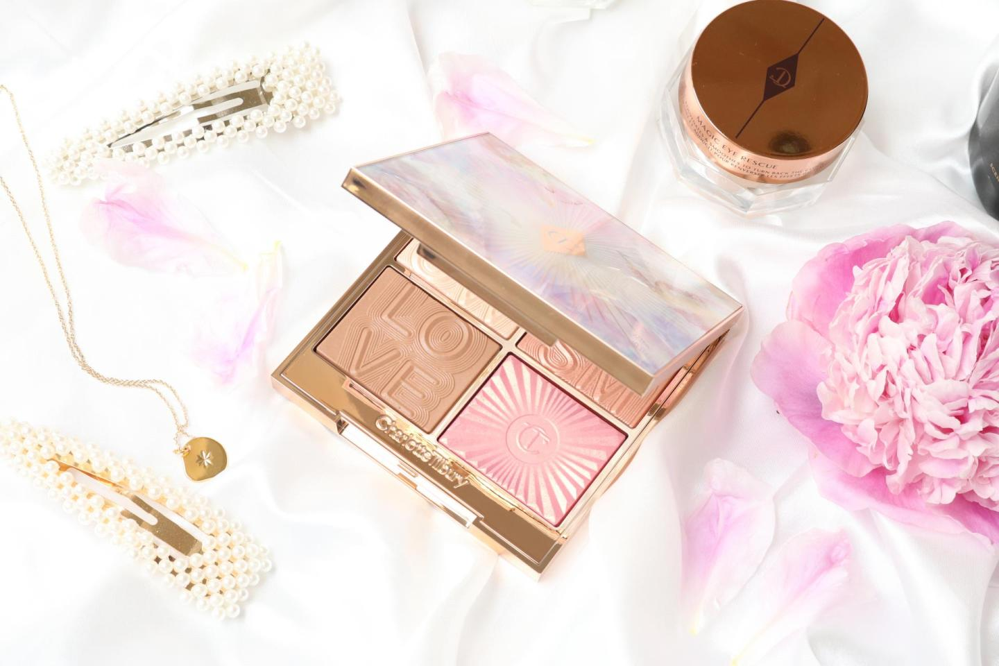 Charlotte Tilbury Glowgasm Face Palette open on a silk sheet