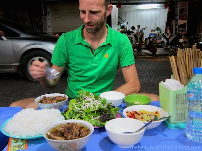 Bún chả (fried pork, cold noddles and fresh herbs) is a must-try – here at 1 Hàng Mành Street.