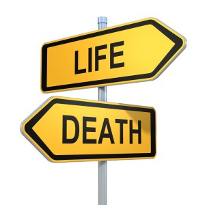 two road signs - life death choice