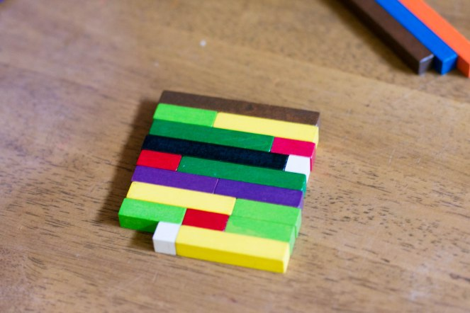 Cuisenaire rods used to show groupings for the number 8 in math