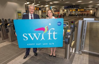 The first Swift design, in giant form, in the hands of transport minister Andrew Jones (and someone else the DfT didn't think was worth mentioning). Photo by Department for Transport [CC BY-NC-ND 2.0] via this flickr page: https://www.flickr.com/photos/transportgovuk/29729521901/in/photolist-CACP6u-C6n92K-CTccGo-D1rJMo-ABT2Kq-NhyZhD-MXSjuf-MwVHG3-MDWWd5-LKzy2H-LKzxZD-MGWznt-Mi6z6P-pAFea1-pzNLxn