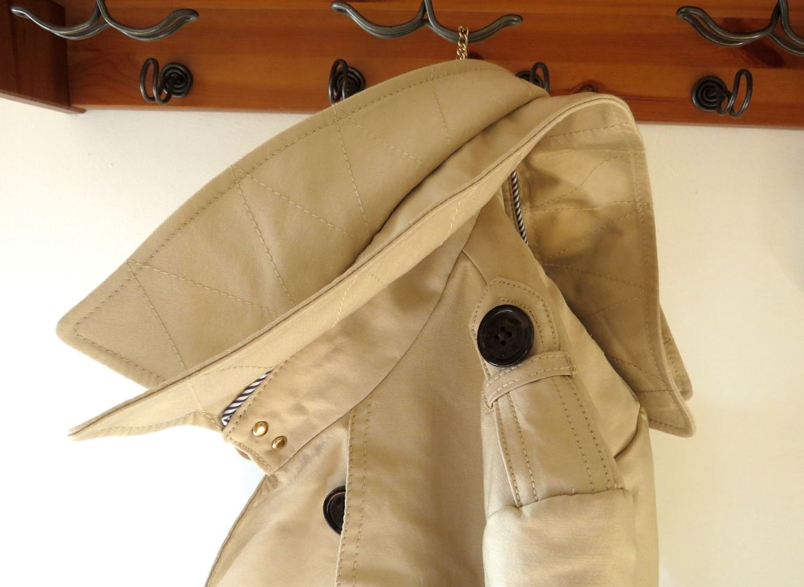 trench coat hanging up