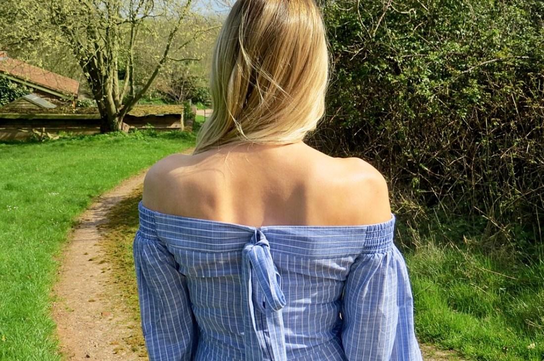 Samantha wearing an off shoulder jumpsuit.