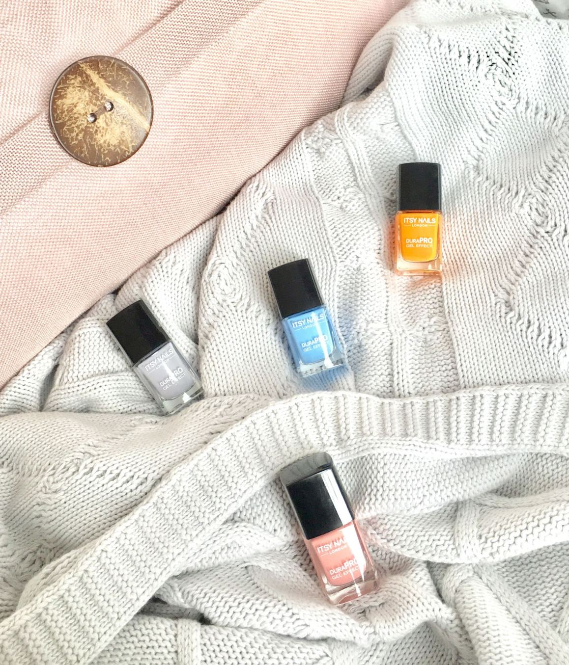 Itsy nails London. polishes scattered on a blanket.