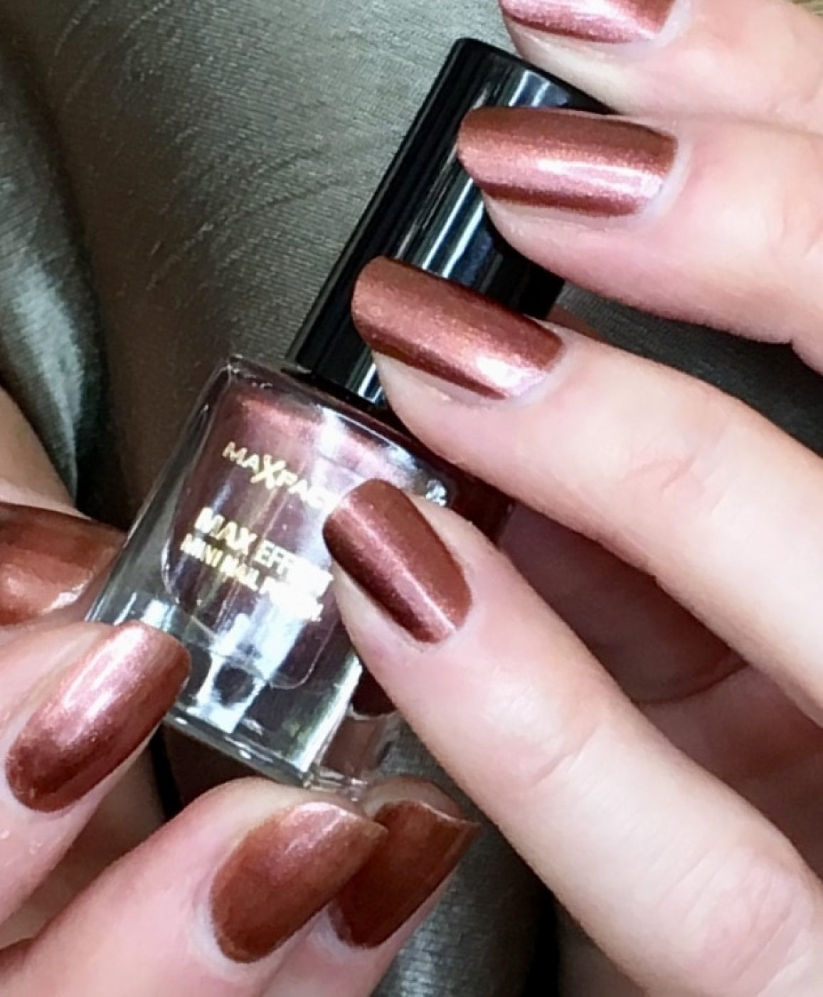 samatha's nails painted in max factor red bronze 03