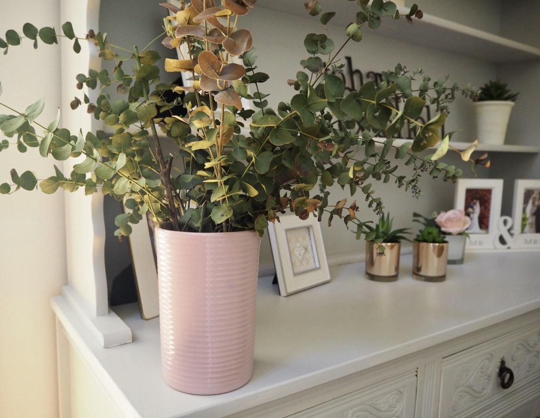 Eucalyptus vase on a dresser. Spring home trend