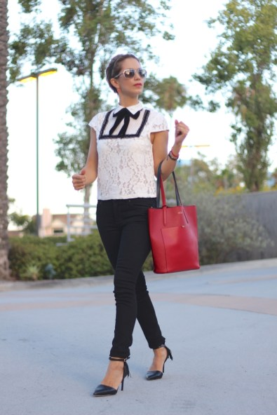 girl wearing a black and white outfit with a pop of red
