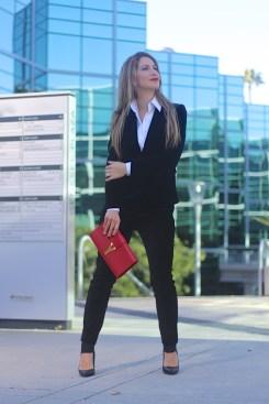 woman wearing a black velvet suit