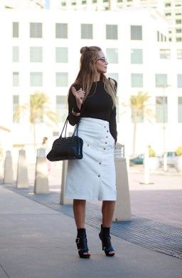 woman wearing a stylish black and white outfit for work