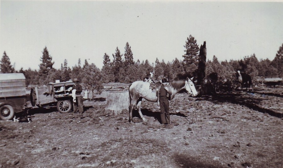 My great uncle and the chuck wagon to his left.