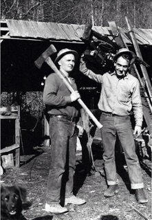 L-R- Lloyd Wheeler, with long-handled sx, and Jack Hopkins with Woodsman Gypo drag saw as redwood timber fallers. Orick, CA. c. 1947.