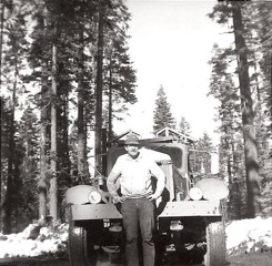 Gypo (independent) logging truck driver, Bob Stoy, with his classic Sterling logging truck. Swain Mountain c. 1965.