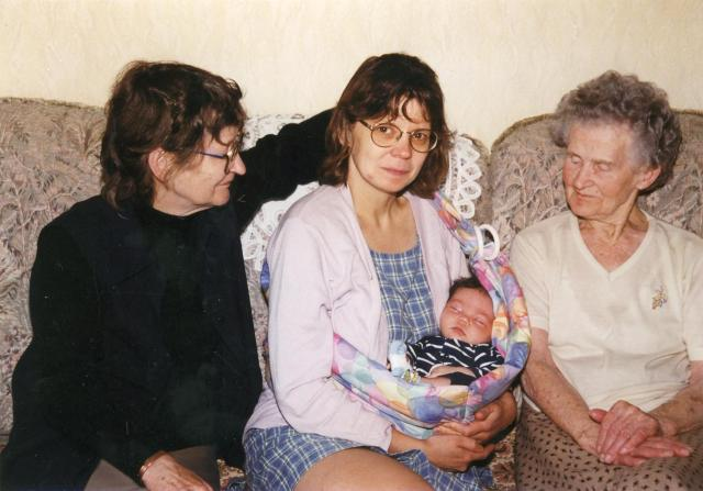 Color photograph of the author (middle) and her daughter, mother (to her left), and maternal grandmother (to her right).