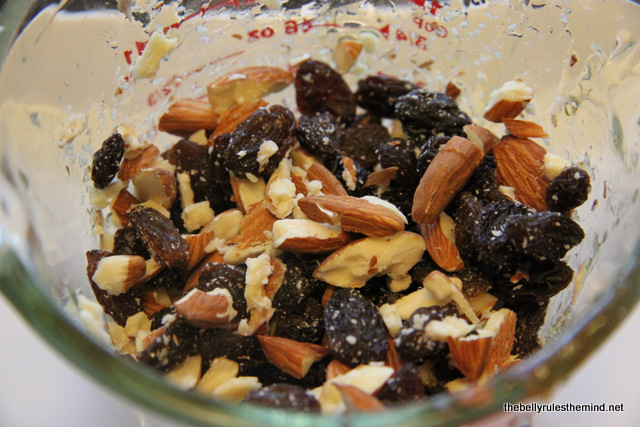 Take 1 cup of assorted nuts and raisins that you would like to use.