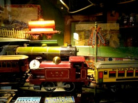 There are hundreds of model trains, cars, trucks from various decades