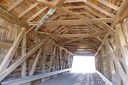Covered bridge, just what I'd wished to see! I love covered bridges - think Bridges of Madison County. Old wooden structures built to keep the bridge clear of snow.