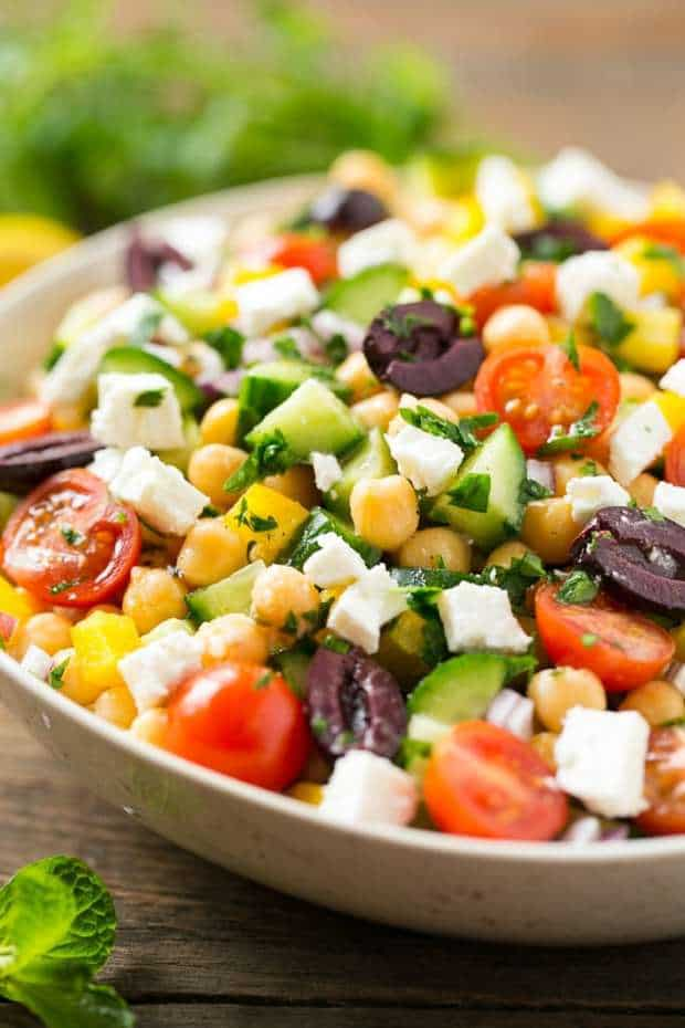This recipe for Chopped Greek Salad is variety of fresh vegetables with chickpeas, creamy feta cheese and olives, all tossed in a Greek lemon and herb vinaigrette.