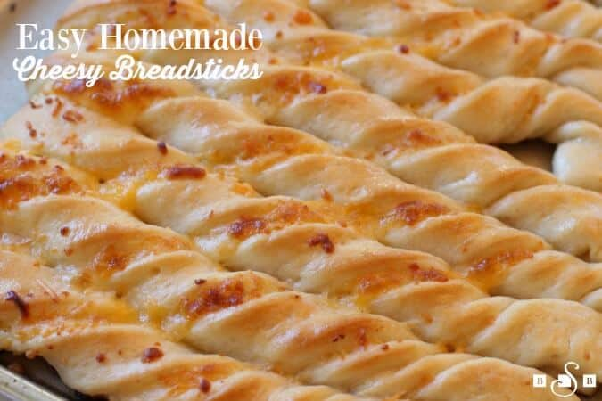 Easy Homemade Cheesy Breadsticks -- are so delicious, they come together easily and they will be a huge hit with your family!