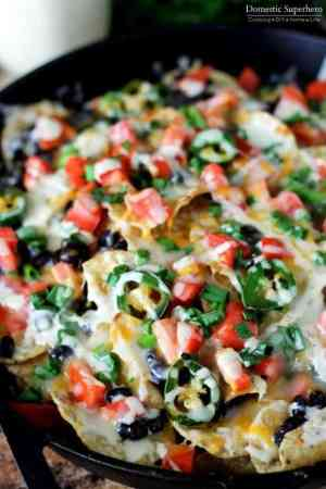 Jalapeno Ranch Black Bean Loaded Nachos -- Definitely make these when you have at least a few people who are around to eat them, otherwise, you may end up eating them all- they are that good.