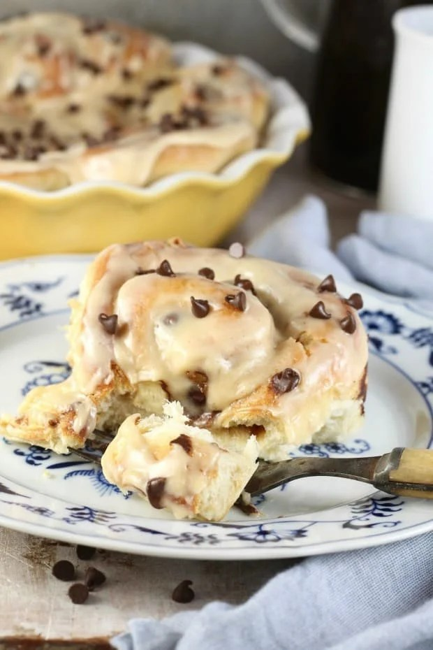 Chocolate Chip Sweet Rolls with Peanut Butter Icing are so decadent and delicious and just perfect for a weekend at home! Serve these up with a steaming cup of coffee or a tall glass of milk.