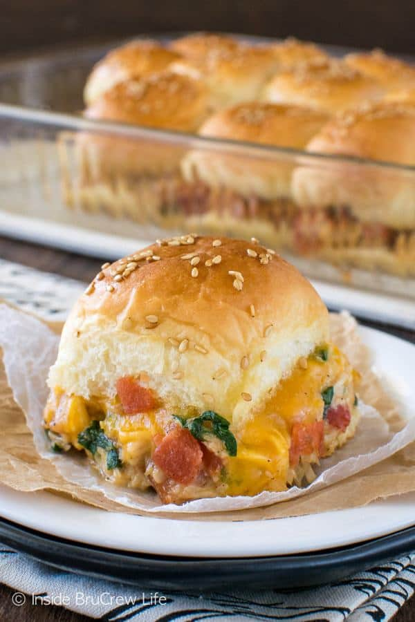 Need a quick and easy meal idea for busy nights? Add these Cheesy Chicken Sliders to your menu and watch everyone devour the loaded dinner rolls when you place them on the table.