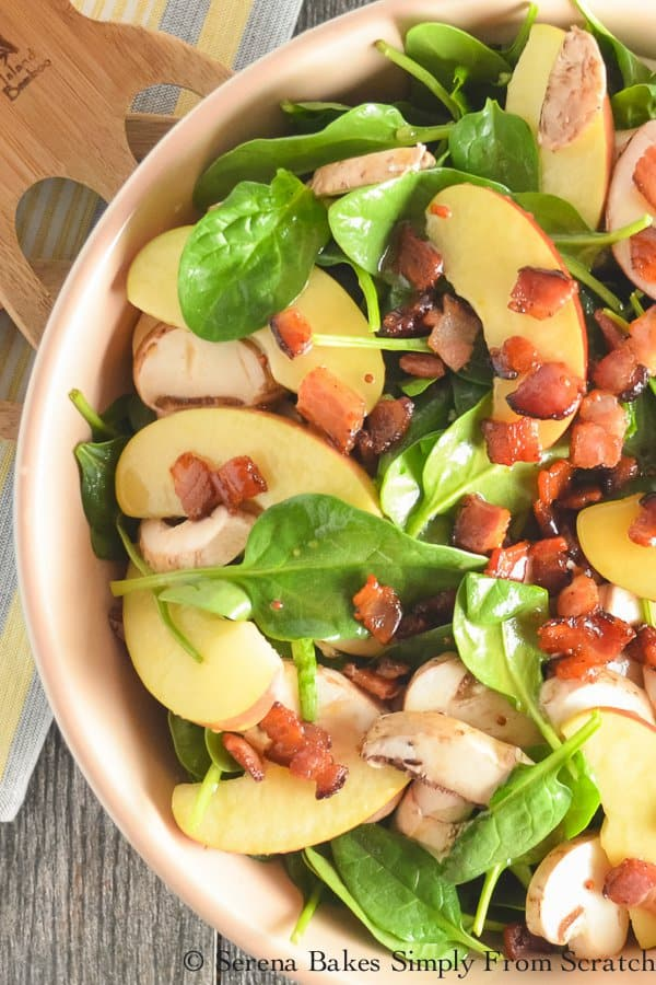 Fuji Apple Spinach Bacon Salad With Creamy Honey Mustard Vinaigrette makes a fun side or light lunch, and is perfect to bring to your next BBQ or Potluck!