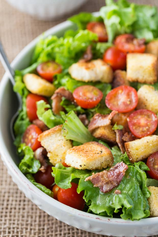 There is so much to love about this salad with its fresh lettuce, juicy cherry tomatoes, crispy bacon pieces, savoury/sweet croutons and a mouthwatering Honey Dijon vinaigrette. We ate it for supper as the main course and found it very filling.