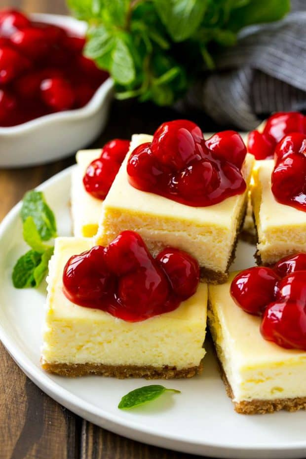 Cherry Cheesecake Bars are the perfect make-ahead dessert for any occasion! Creamy cheesecake sits atop a homemade graham cracker crust, and is finished off with a generous helping of cherries.
