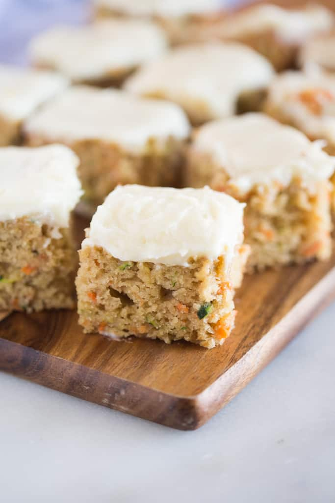 Carrot and Zucchini Bars with Lemon Cream Cheese Frosting are moist, perfectly sweet, and one of my favorite snack cakes. They taste amazing and are a great way to sneak vegetables into a yummy treat!