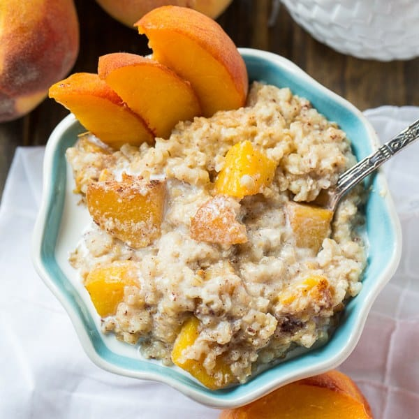 Crock Pot Peaches and Cream Oatmeal made with steel cut oats, cinnamon, and brown sugar is an irresistible flavor combination. It cook up effortlessly in the crock pot and is a great way to turn summer peaches into a warm and comforting breakfast.