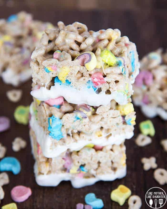 Lucky Charms Rice Krispie Treats are delicious gooey krispie treas made with lucky charm cereal instead! Dip Them in white chocolate for a super fun sweet treat!