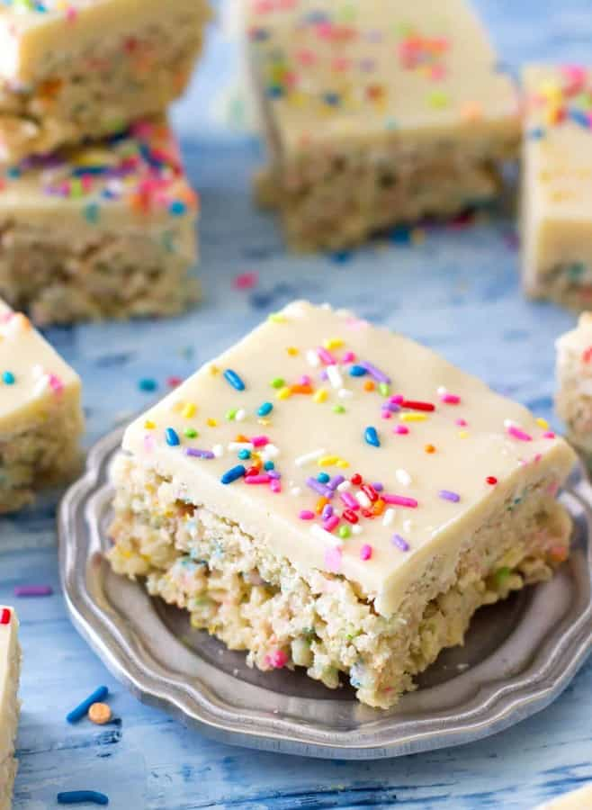 Sweet, generously-sprinkled funfetti cake batter rice krispie treats iced with a cake batter fudge frosting.